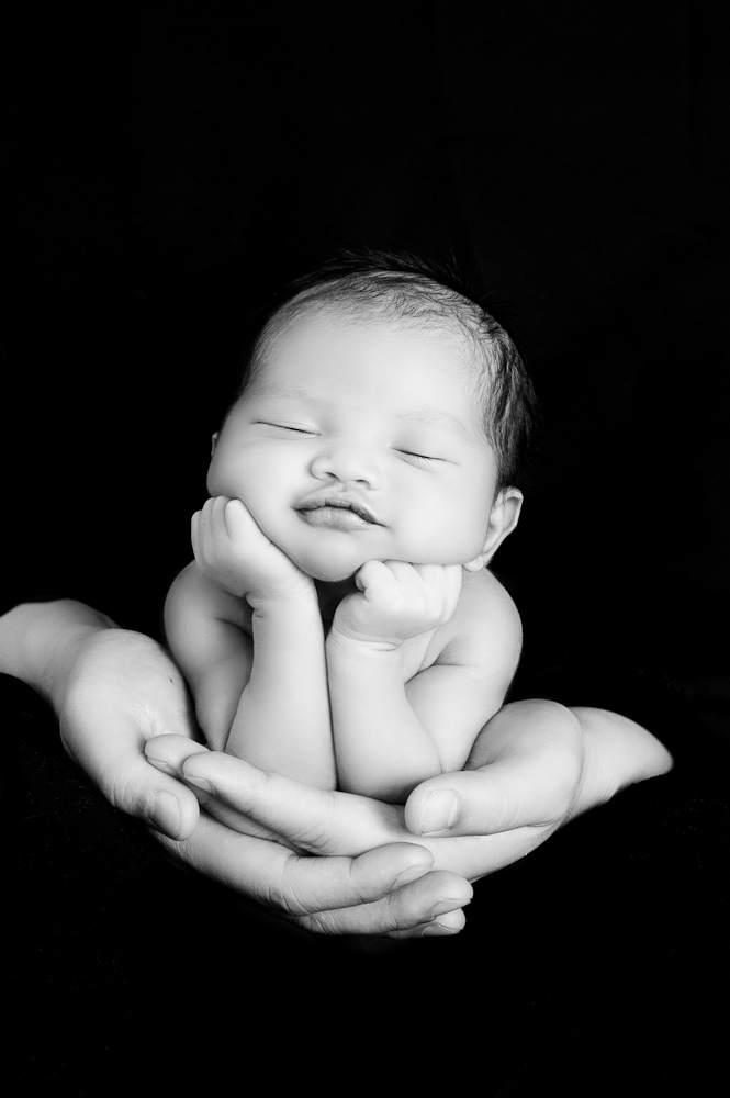 Newborn photography the controversial new trend